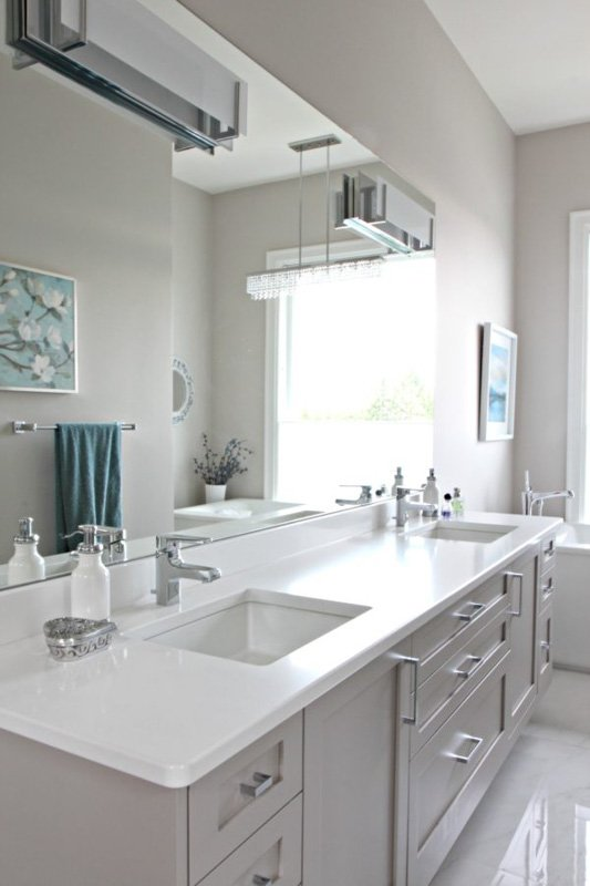 Dorian Gray paint on bathroom cabinets with lighter gray walls.