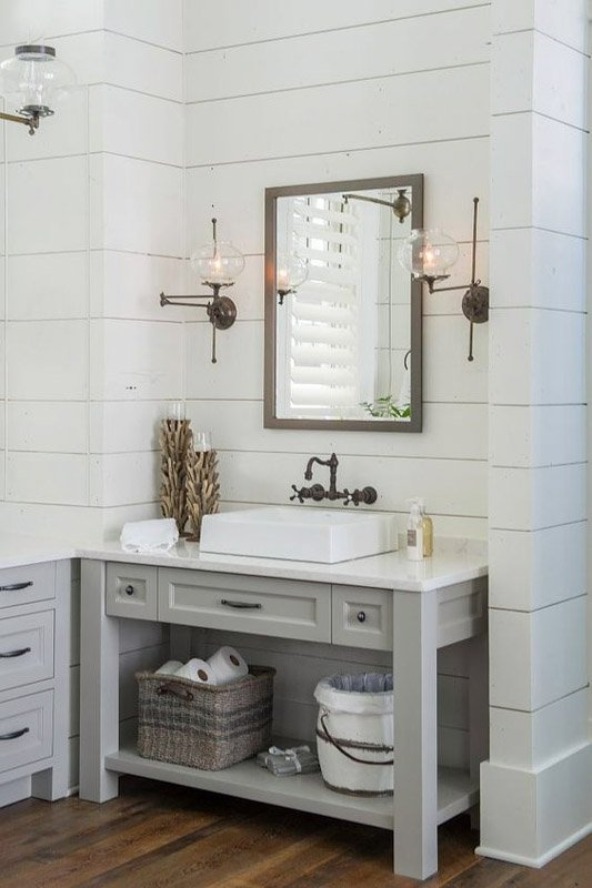 Dorian Gray paint on bathroom vanity agains lighter shiplap walls and vintage bathroom hardware.