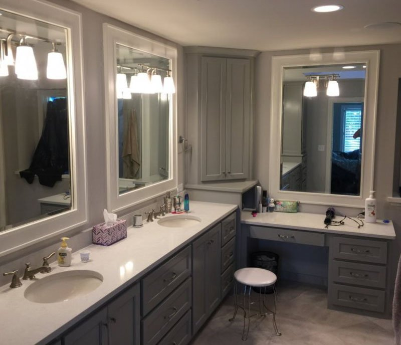 Large bathroom with cabinets painted in Sherwin Williams Dorian Gray paint.