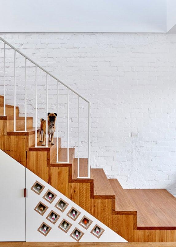 Modern wine storage under the stairs.