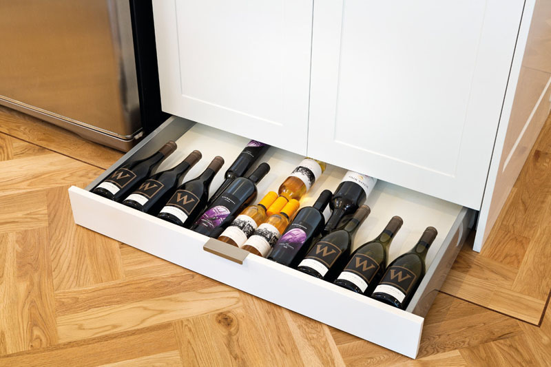Toe kick wine drawer for the kitchen.