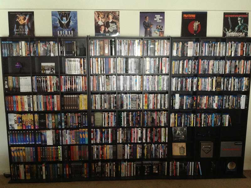 An homage to video stores of the past with an entire wall of DVD shelving.