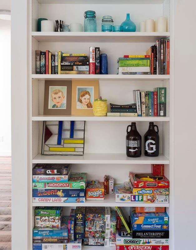 Built-in shelves can contain everything from books to board game boxes.