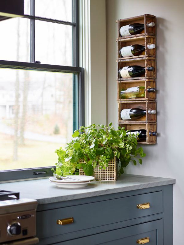 Vintage wooden drawers used to create a DIY wall-mounted wine rack.