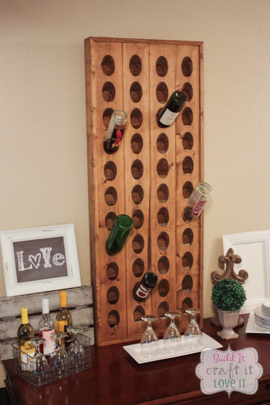 Wall-mounted wooden wine bottle holder.