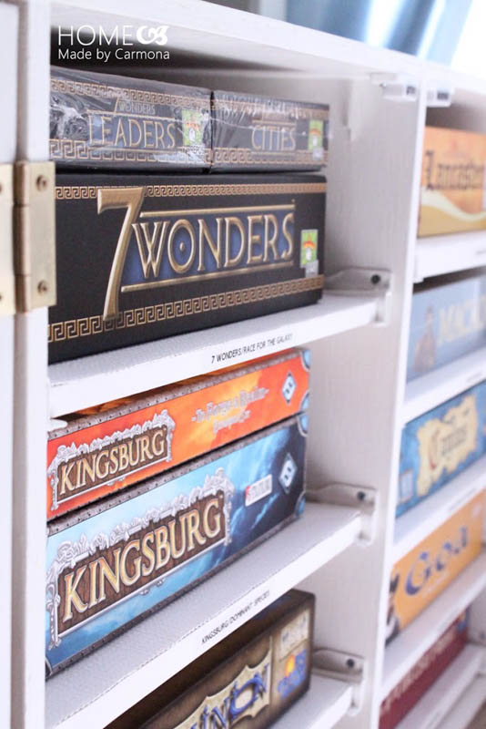 A DIY board game unit to keep colorful boxes stowed away out of sight.