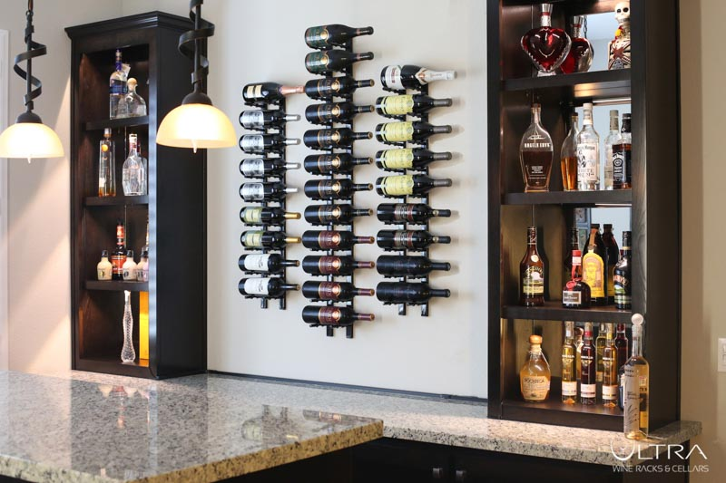 Wall mounted wine rack for wine storage in the kitchen.