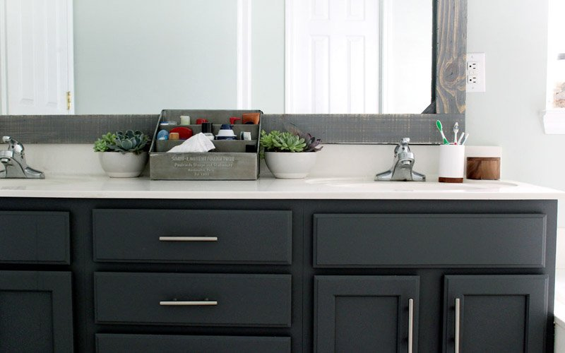 DIY bathroom update - the new vanity color transforms the look of the countertop.