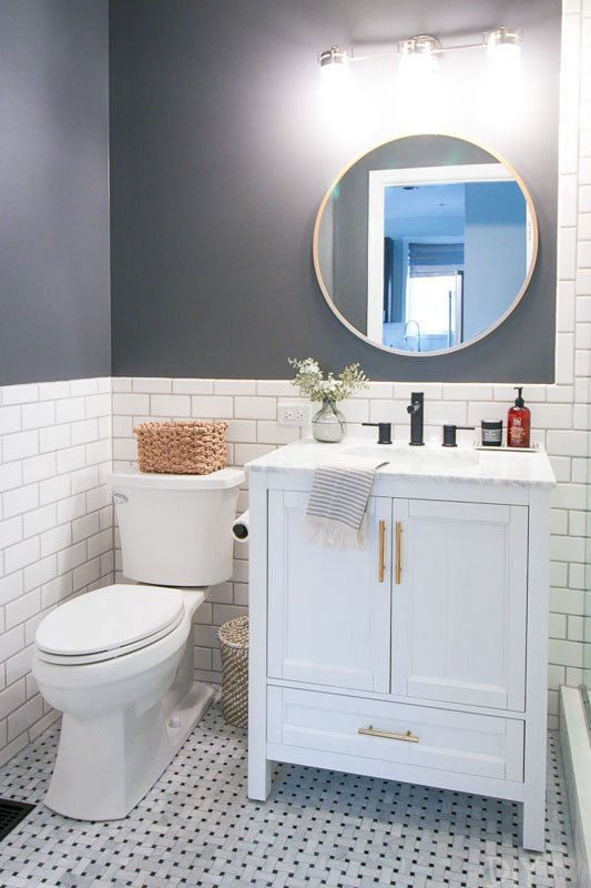 Bathroom with white subway tile half wall and SW Peppercorn accent wall color.