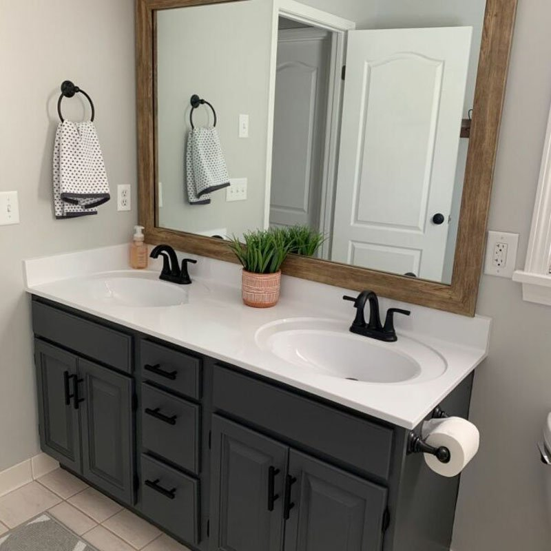 DIY bathroom update with painted light fixture, countertops and vanity cabinets in SW Peppercorn.