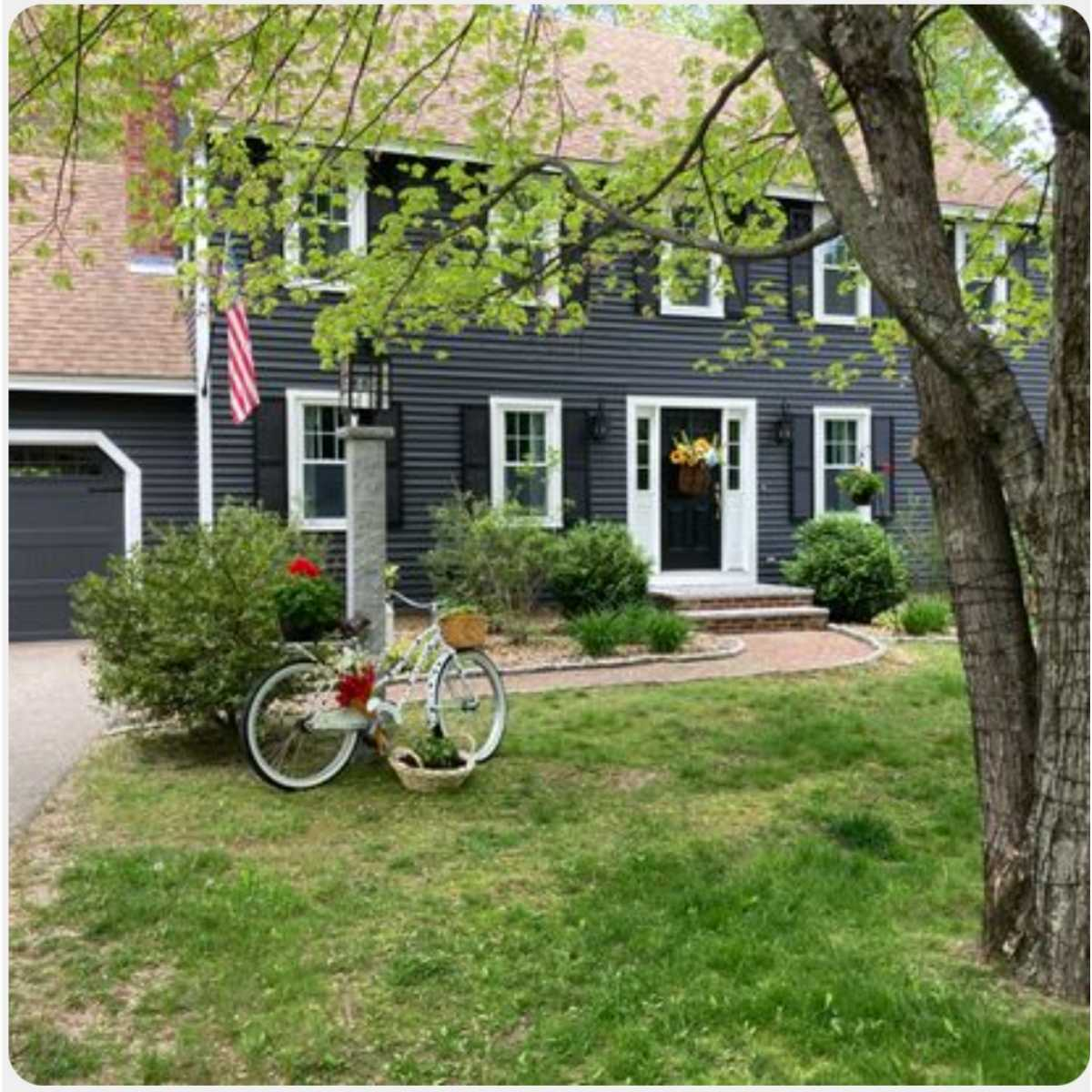 Sherwin Williams Iron Ore home exterior with Tricorn Black shutters and Extra White trim