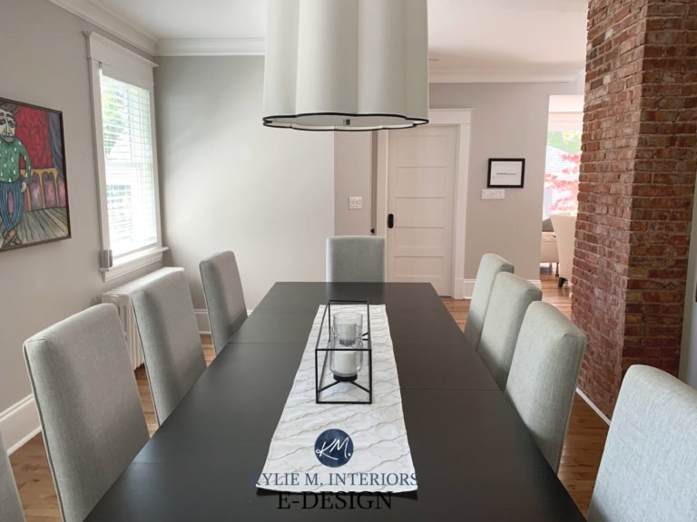 Modern dining room with brick accents and Benjamin Moore Collingwood paint on the walls.