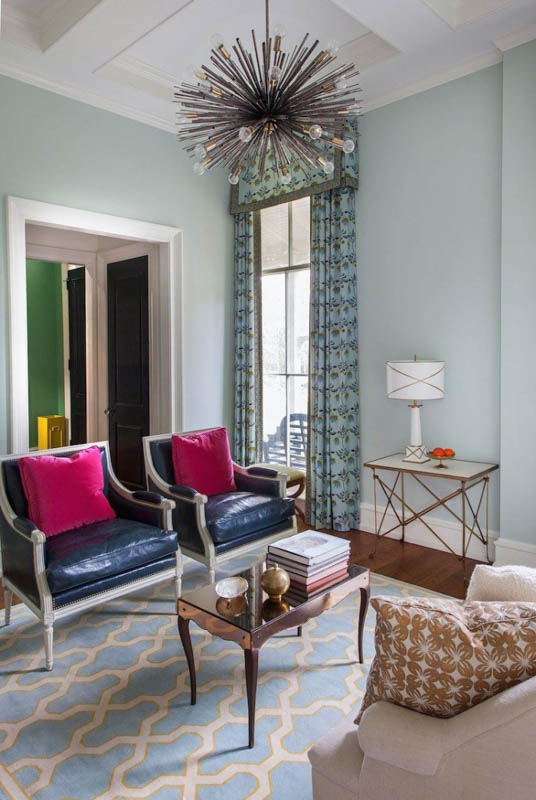 Sitting room with Benjamin Moore Quiet Moments walls and colorful decor accents.