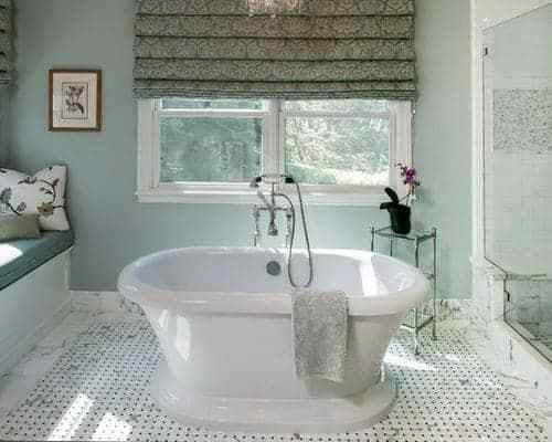 Quiet Moments paint color in a bathroom with soft lighting, traditional decor accents and a sparkling white freestanding tub.