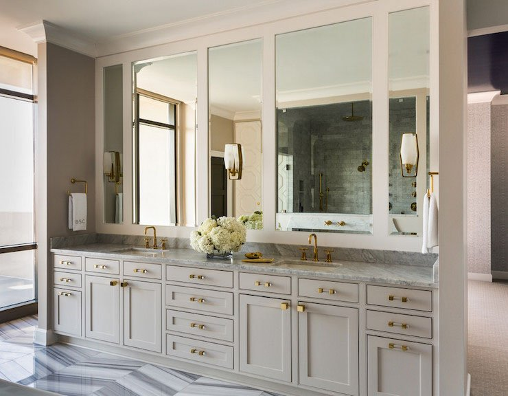A large vanity painted Sherwin Williams Alpaca with large mirrors above.