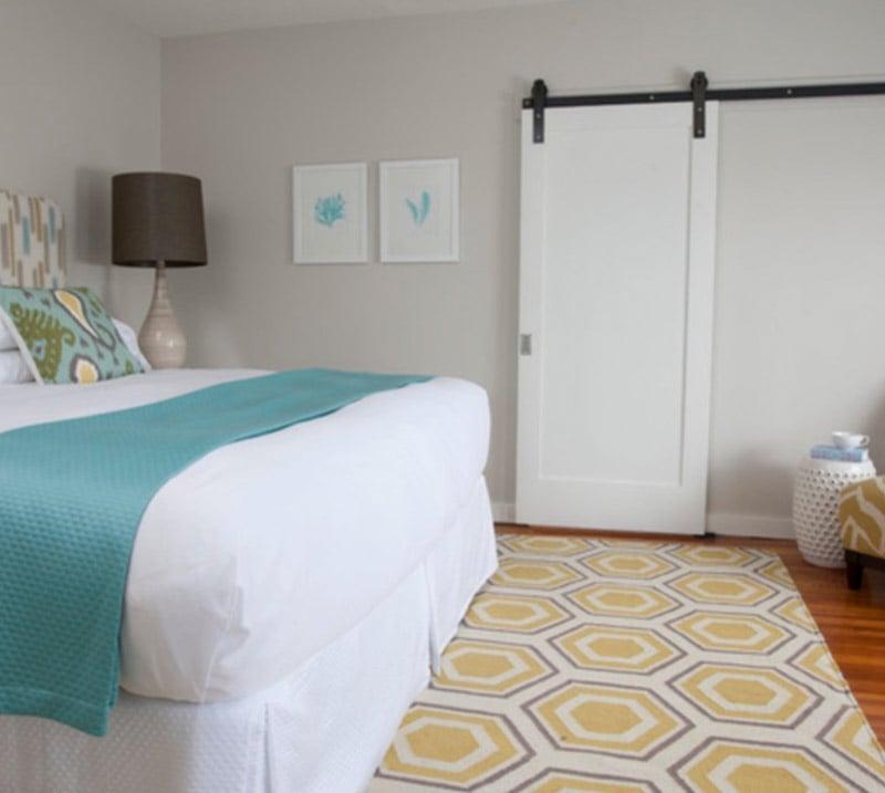Bedroom with Benjamin Moore Collingwood walls and white sliding barn door.