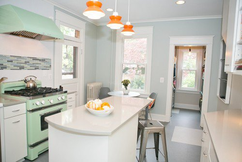 Retro-inspired kitchen with mint green, vintage stove and range hood and walls painted in Benjamin Moore Quiet Moments.
