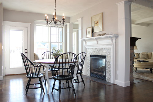 Kitchen nook with a small, round table next to a tiled fireplace with a white mantle, and Alpaca interior paint.