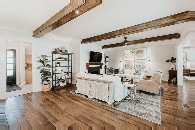 Collingwood walls allow the ceiling beams and hardwood floors be the stars of this farmhouse-inspired living room.