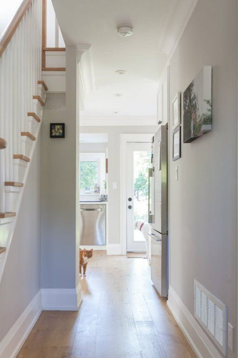 Hallway with Collingwood wall paint and white trim.