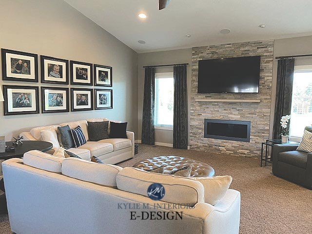 A cozy living room with gallery wall style family photos and anew gray interior walls.