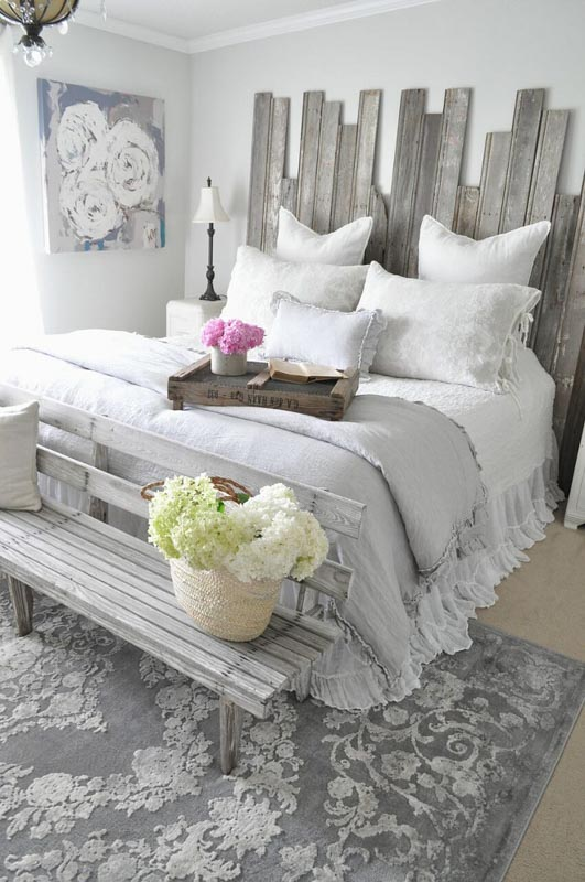Shabby-Chic bedroom with reclaimed wood headboard and Behr Silver Drop wall paint.