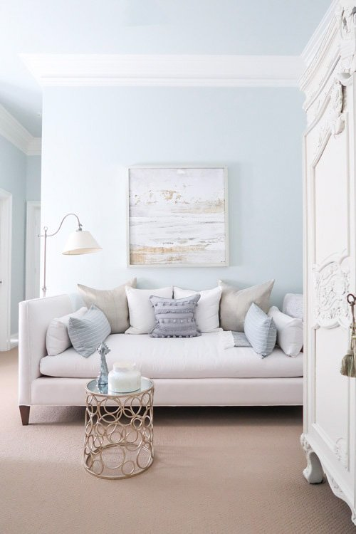 Quiet Moments paint at 50% intensity, paired with white trim and furniture.