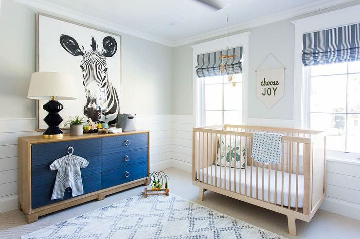 Nursery with Behr Silver Drop on the upper walls, shiplap lower walls, blue decor accents and zebra wall art.