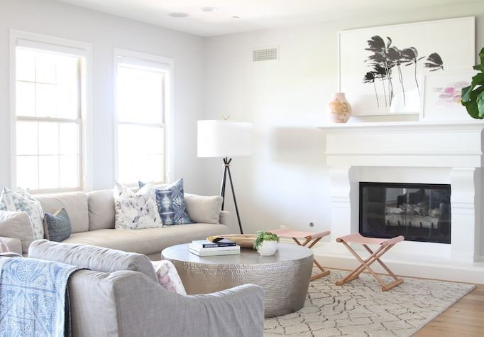 Mid-Century Eclectic Living Room with white trim fireplace, neutral tones and blue decor accents and Behr Silver Drop wall paint.