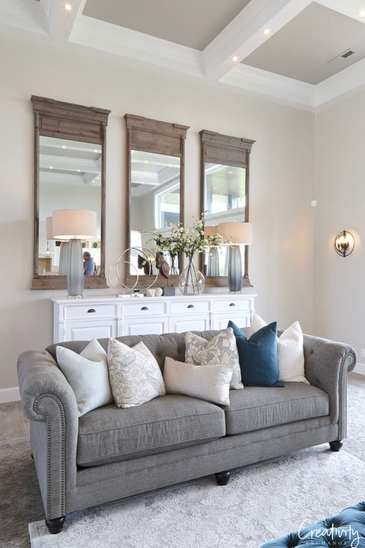 As a wall color, Benjamin Moore Collingwood provides stunning contrast with white crown moulding and ceiling beams.