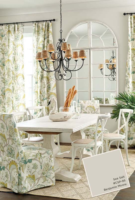 Dining room with BM Sea Salt paint color walls and printed curtains and chairs.