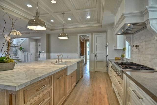 Alpaca paint used in a large open concept kitchen space with marble and wooden accents.