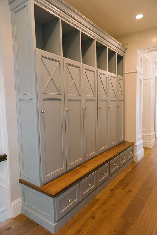 Mudroom with Sea Salt Paint Benjamin Moore and cabinets in Wedgewood Gray.
