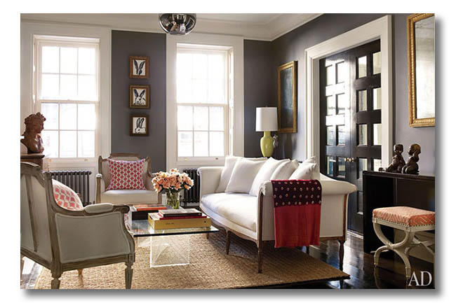 Benjamin Moore Chelsea Gray wall color in a vintage-inspired sitting room, contrasting with white trim.