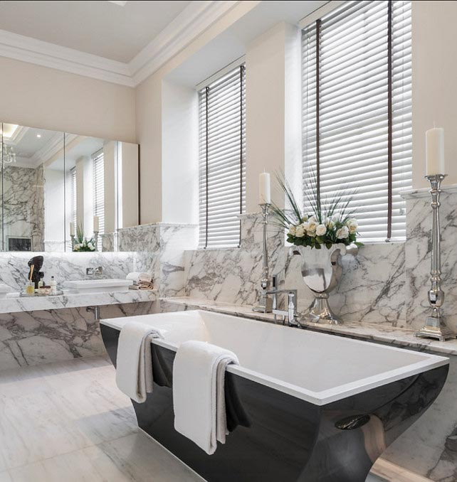 Bathroom with marbled backsplash throughout, and Benjamin Moore Collingwood paint on the upper walls.