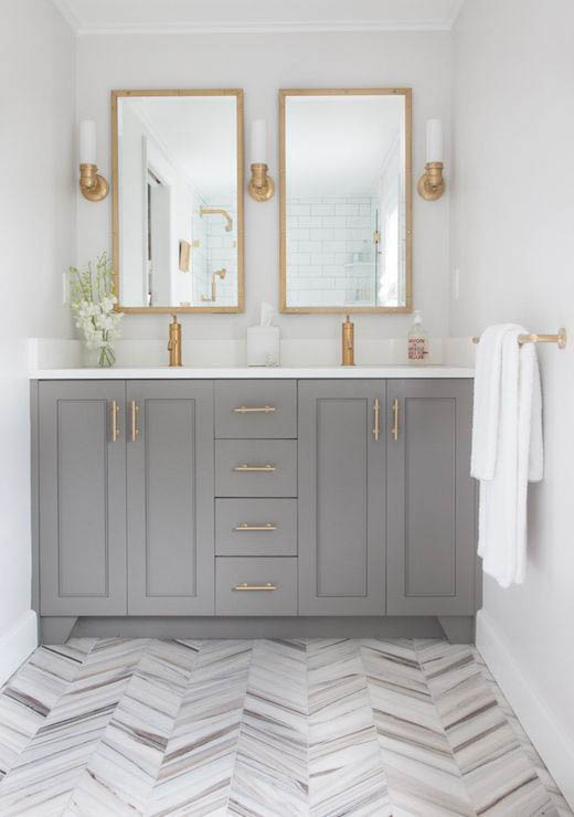 Gorgeous bathroom with vanity painted in Chelsea Gray, paired with gold hardware.