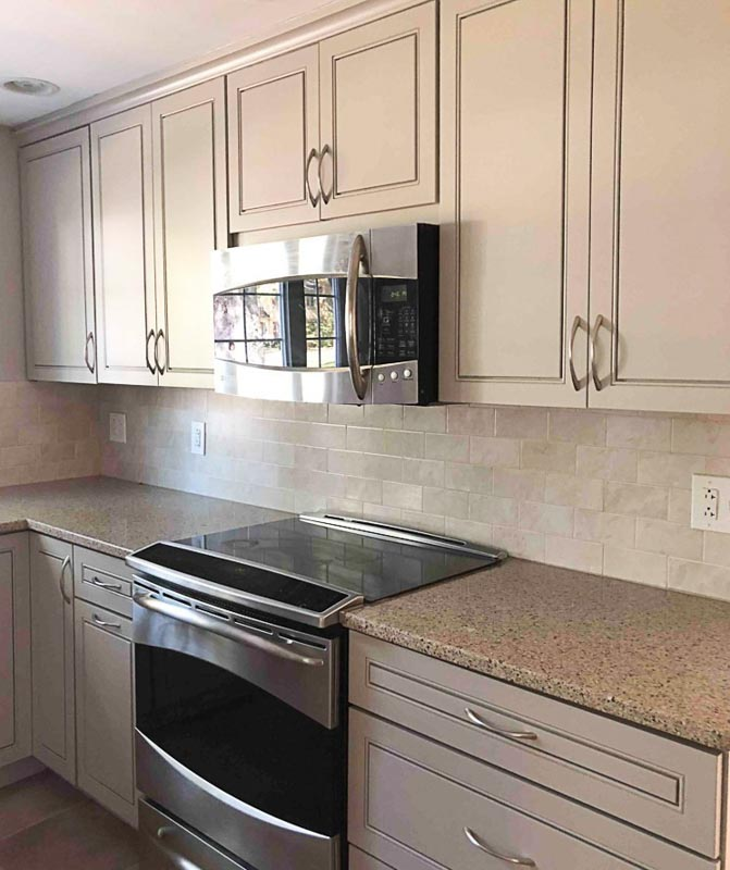 A basic kitchen with cabinets painted in Anew Gray by Sherwin Williams.