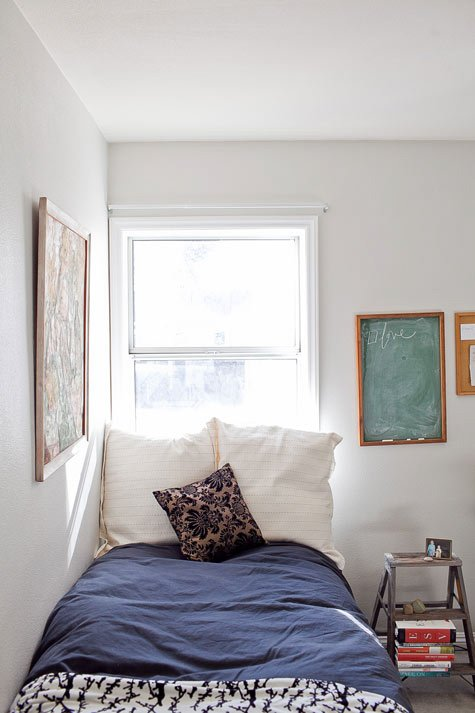 Understated bedroom with a subtly schoolhouse vibe and Behr Silver Drop wall paint.