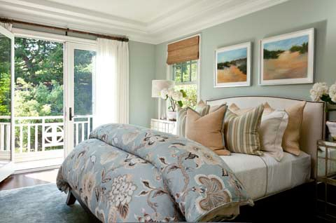 Quiet Moments shows its rich yet muted green tones in this warmly lit, cozy bedroom.