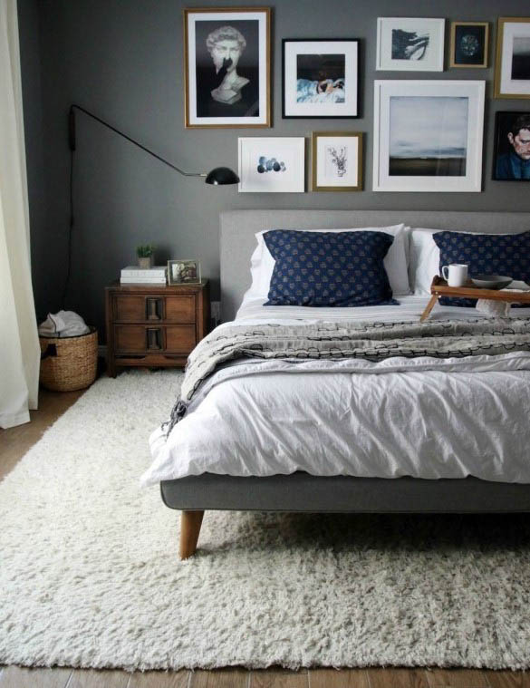 Chelsea Gray as a wall color in a bedroom with gallery wall.