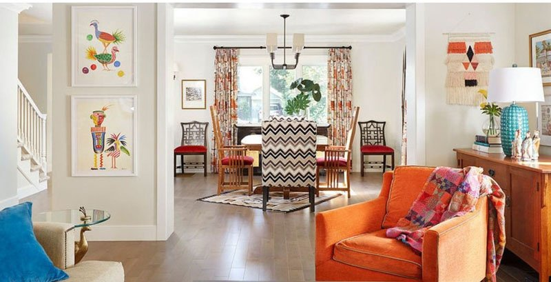 Bohemian decor, brightly colored decor, orange chair and walls in Sea Salt paint Benjamin Moore.