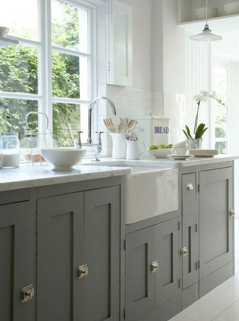 Bright, white kitchen with cabinets painted in Chelsea Gray by Benjamin Moore.