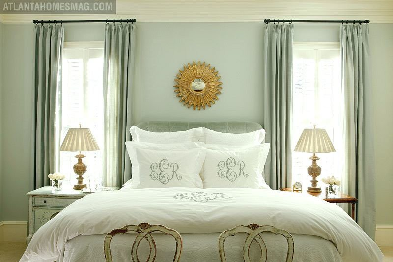 Bedroom with white and pale green decor palette, and wall shade in Benjamin Moore Quiet Moments.