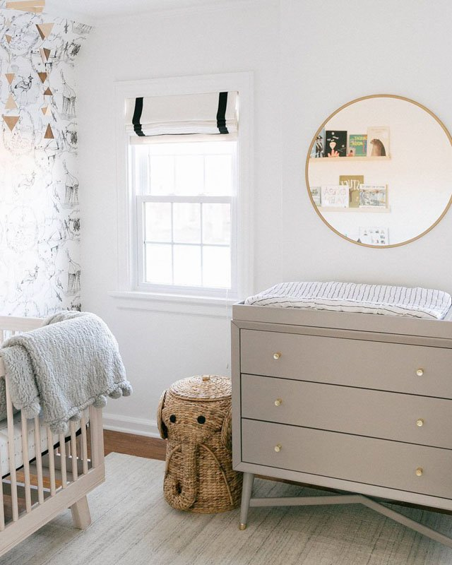 A gender neutral nursery set up with a changing table that is painted in Alpaca paint.