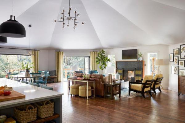 Open-concept living and dining area of a home with SW Alpaca paint on the walls.