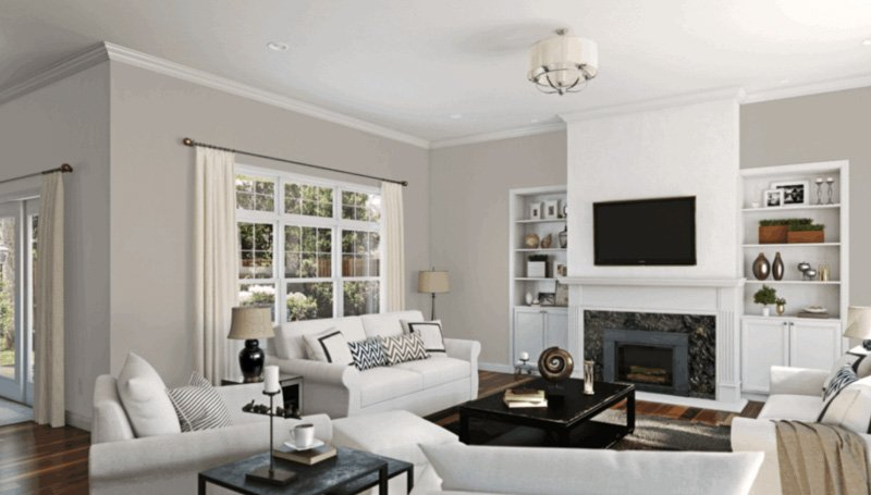 A living area with white built ins and furniture, painted in a greige color.