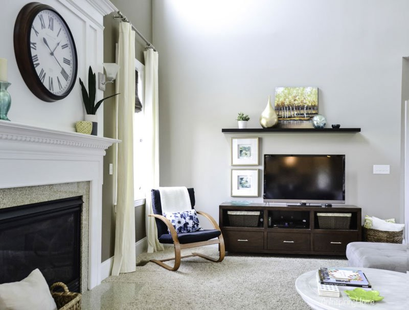 Creamy anew gray paint featured in a casual living room setup.