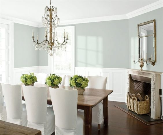 Elegant dining room looks light and bright with Quiet Moments paint color and white trim.