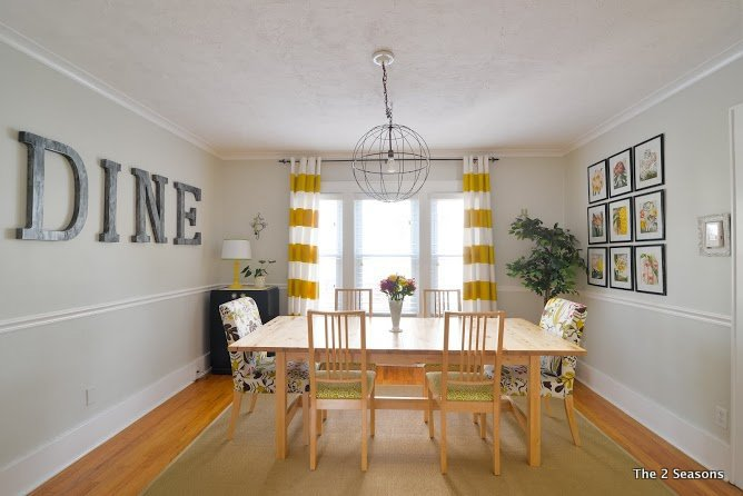 Behr Silver Drop works perfectly as a warm gray in this dining room with sunny yellow decor accents.