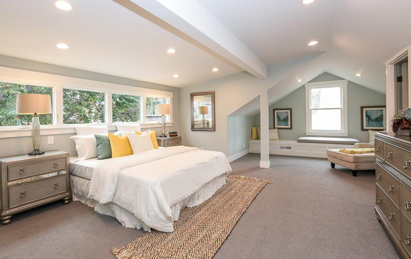 A stunning and unusually-shaped bedroom with Benjamin Moore Quiet Moments on the walls and white ceiling and trim.